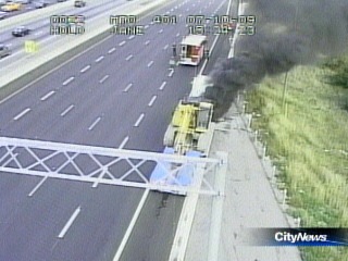 Tractor Trailer Fire Squeezes Traffic On 401 Eastbound Collectors At