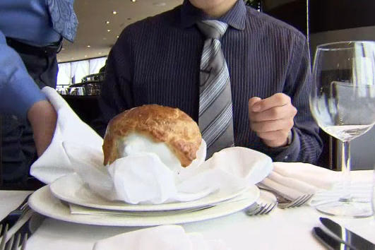 Man Is Served Food At Table