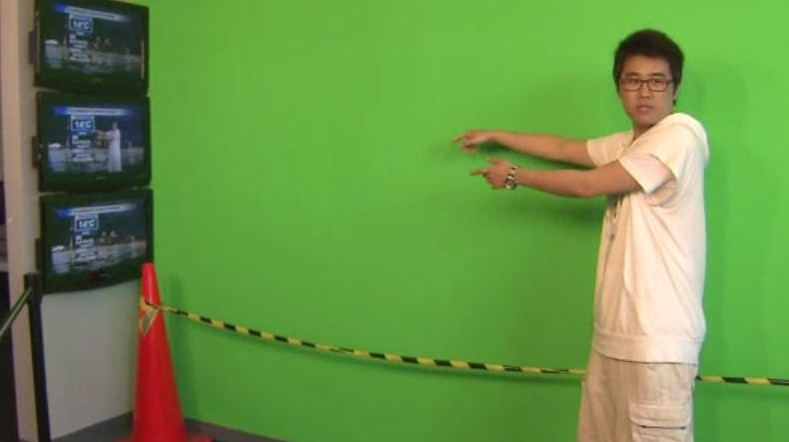 A visitor to Citytv and OMNI headquarters has fun at the green screen at the weather centre. CITYNEWS