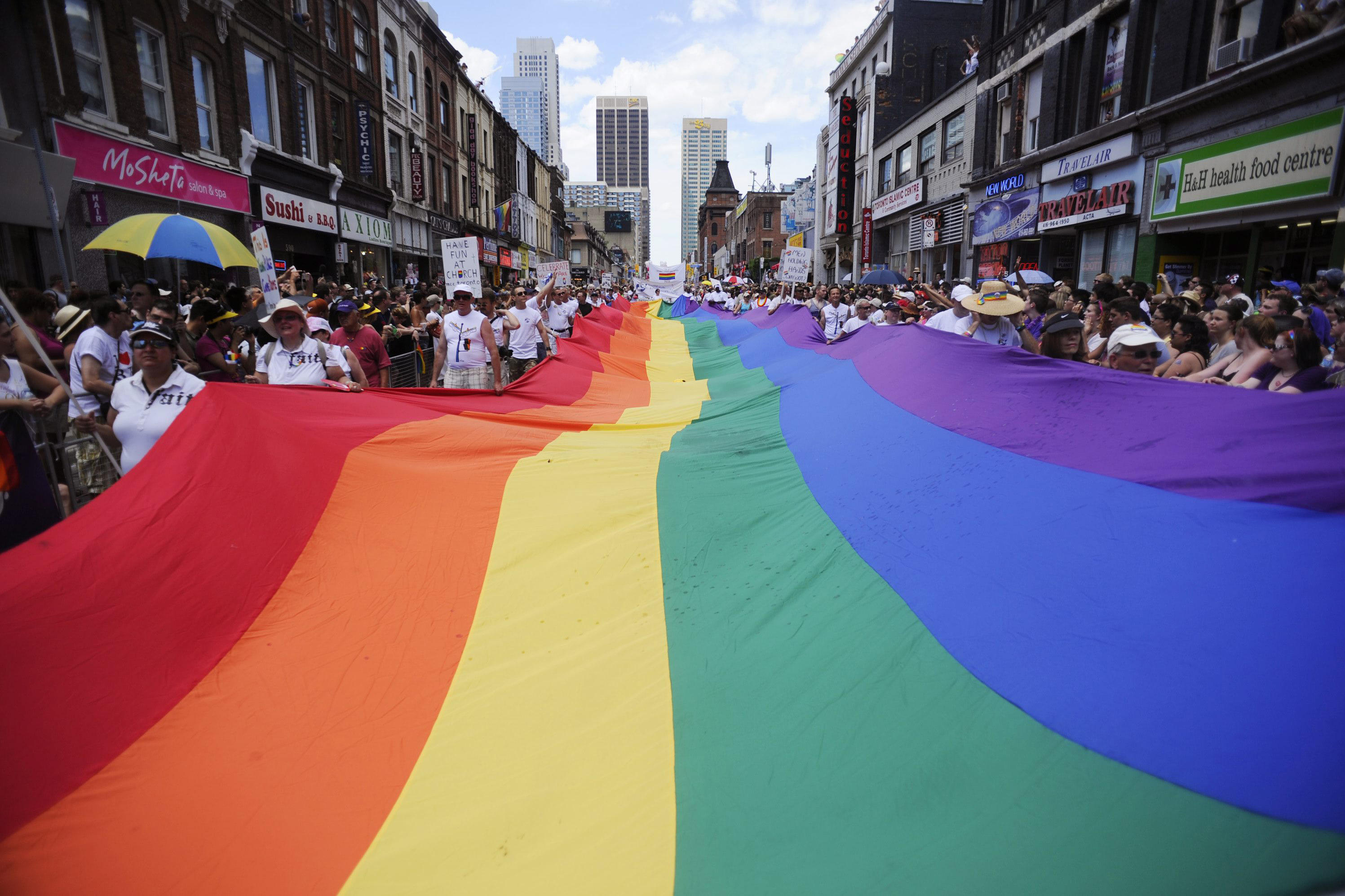 People take part in the annual Pride Parade in Toronto on July 3, 2011. THE CANADIAN PRESS/Ian Willms