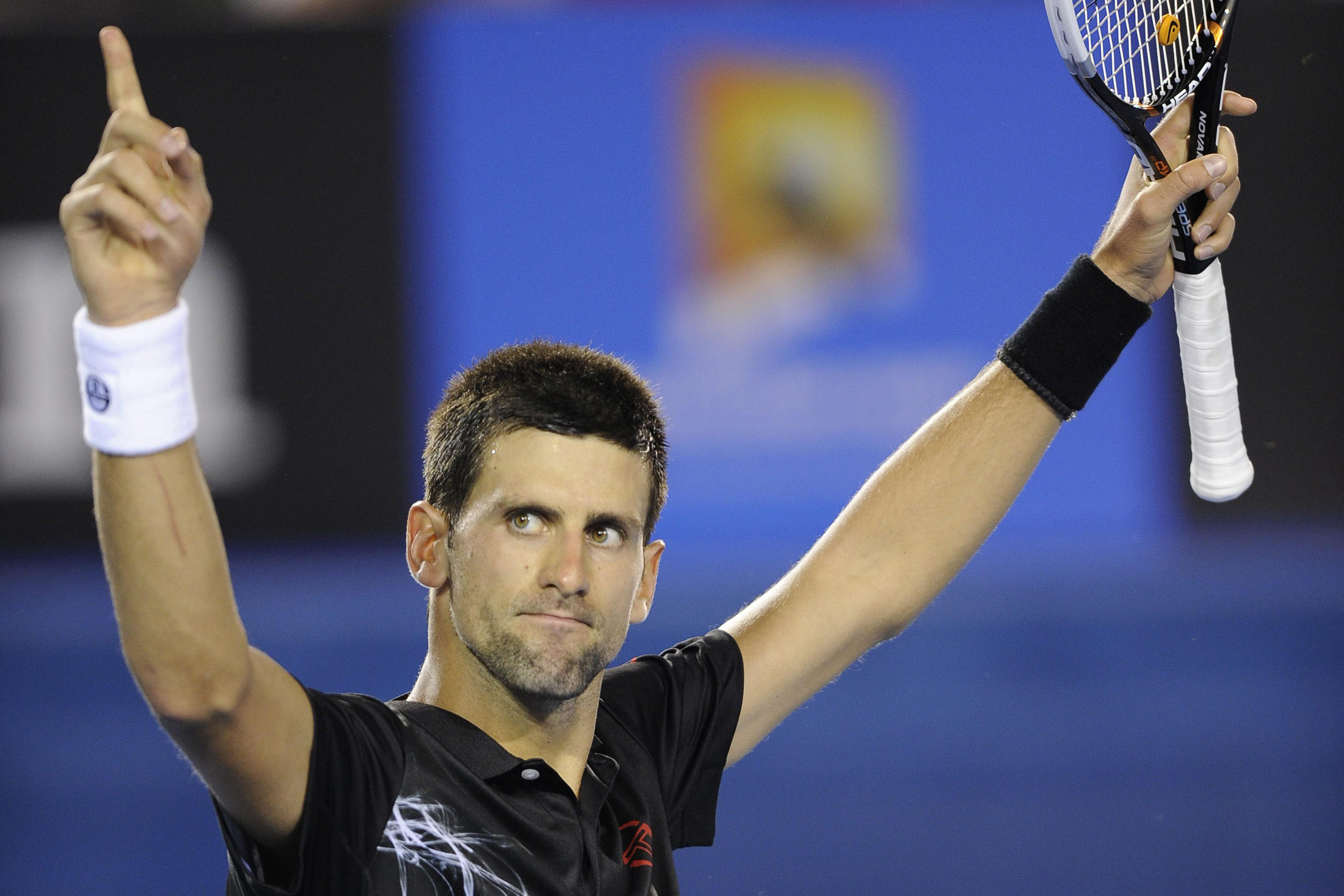 Novak Djokovic of Serbia celebrates after defeating Lleyton Hewitt in Melbourne, Australia, on Jan. 24, 2012. THE ASSOCIATED PRESS/Andrew Brownbill