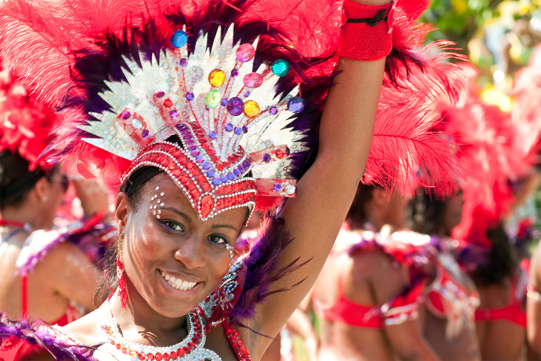 A woman dances in costume at Caribbean Carnival Toronto on July 30, 2011. FLICKR/Chris Cheung
