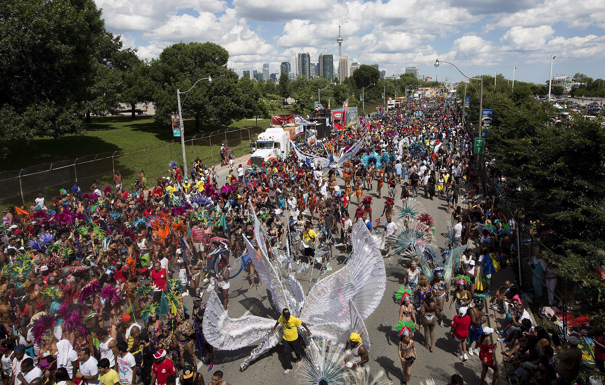 Paraders march down Lakeshore Boulevard at the Caribbean Carnival in Toronto on Saturday, August 3, 2013. THE CANADIAN PRESS/Michelle Siu