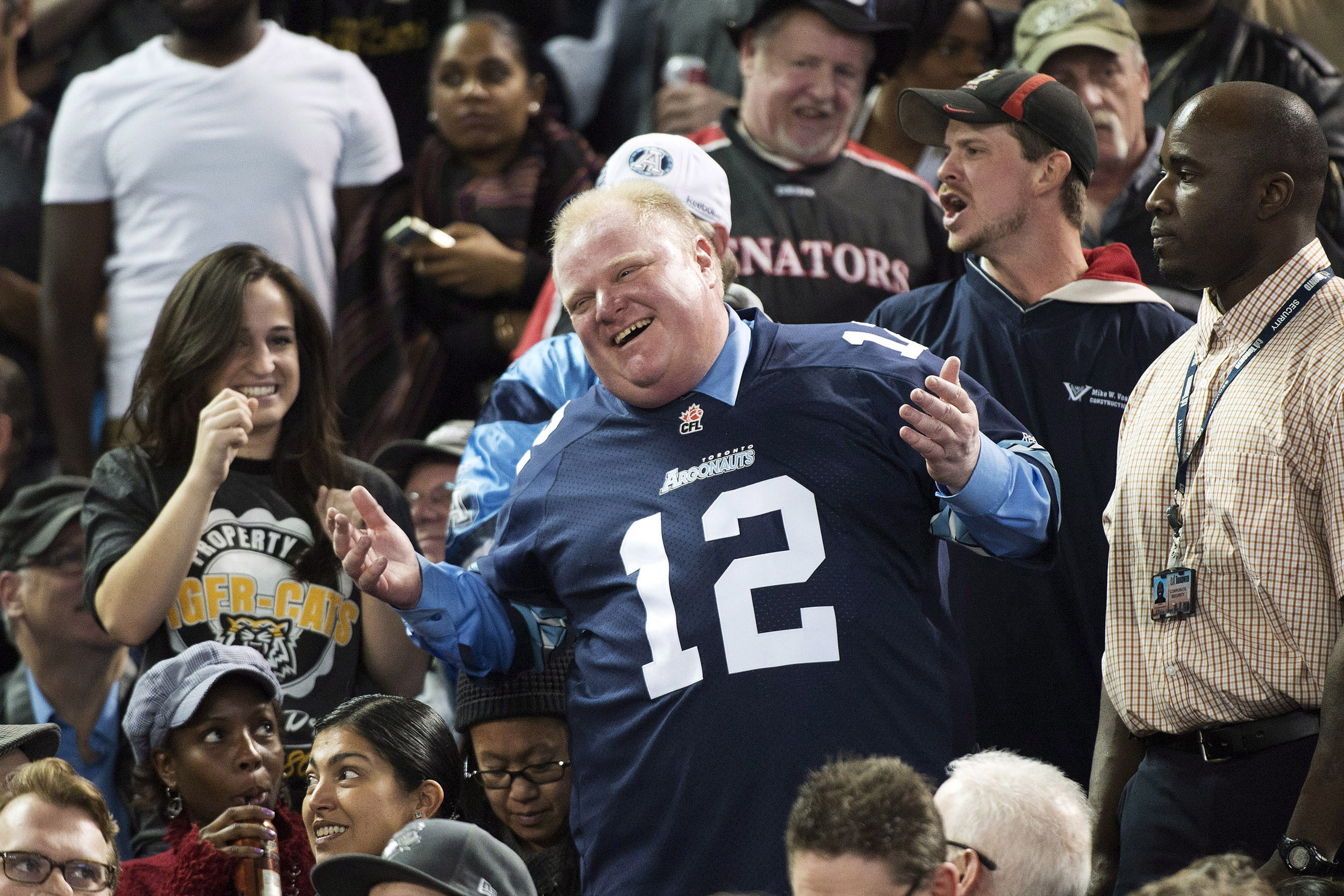 Mayor Rob Ford laughs with fans as he attends the Toronto Argonauts and Hamilton Tiger-Cats CFL Eastern Conference final football game in Toronto, Nov. 17, 2013. THE CANADIAN PRESS/Nathan Denette