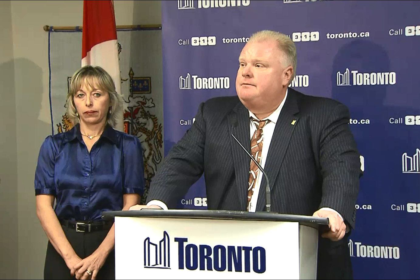 Mayor Rob Ford talks to reporters at city hall in Toronto on Nov. 14, 2013, as his wife Renata looks on. CITYNEWS.