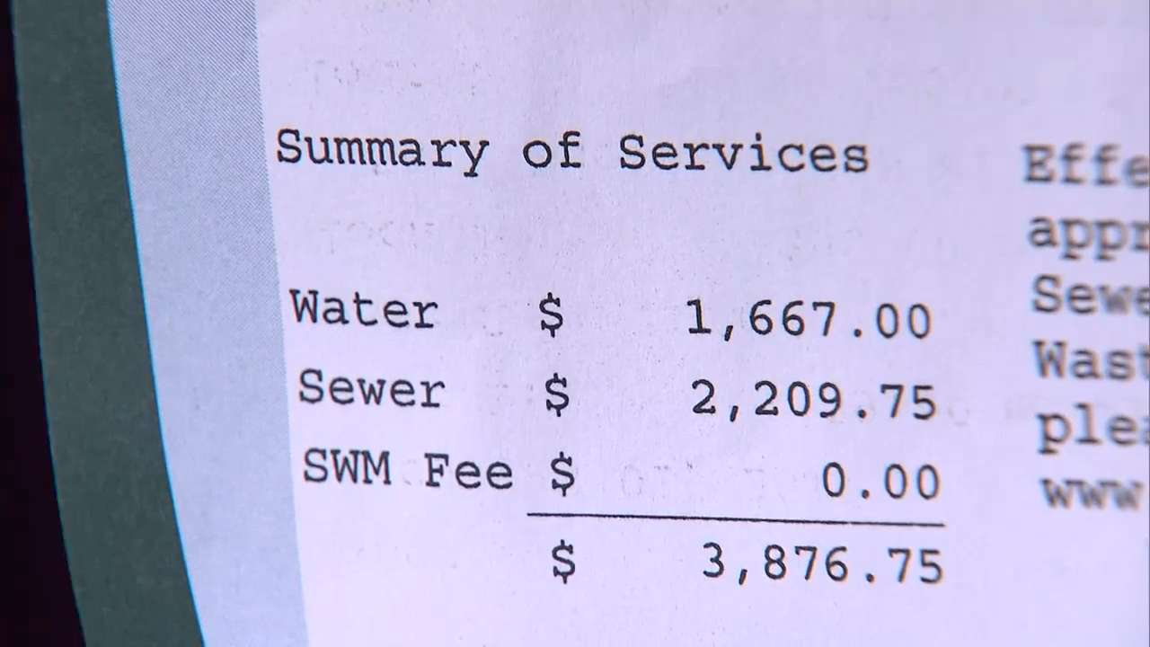 Family charged thousands for water bill back payments