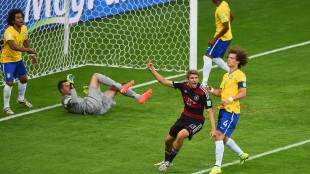 Thomas Mueller of Germany celebrates scoring his team's first goal pa