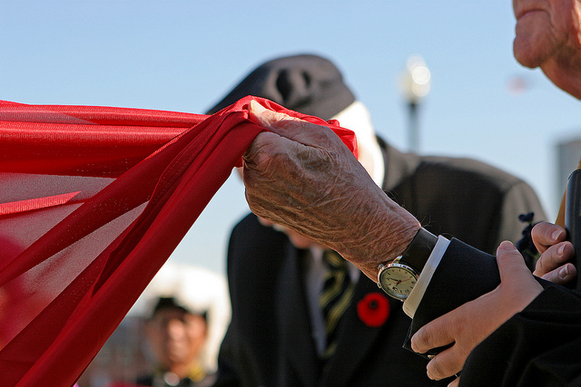 A veteran clutches the Canadian flag during a Remembrance Day ceremony in the GTA. CITYNEWS/Michael Talbot.