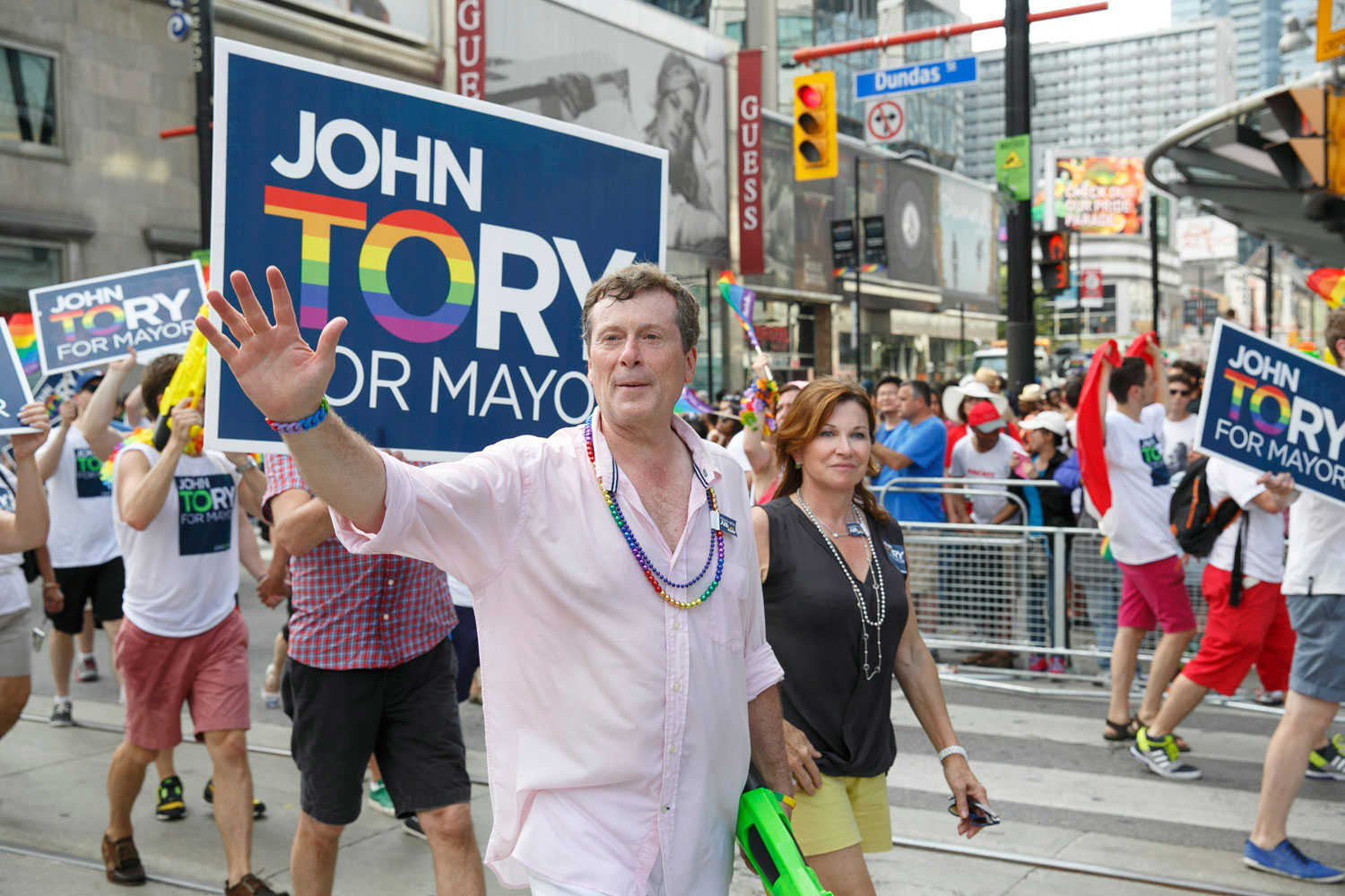 Mayoral candidate John Tory marches in the WorldPride Parade on Yonge Street on June 29, 2014. THE CANADIAN PRESS/Michael Hudson