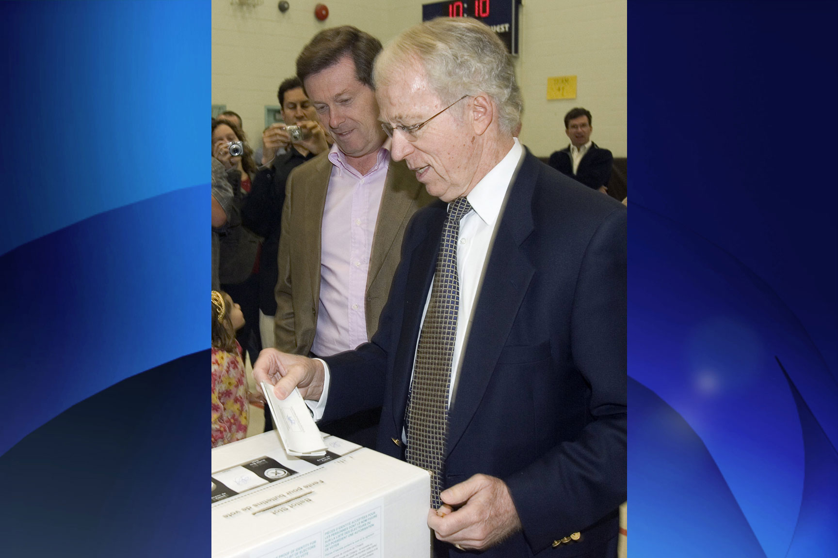 Ontario PC leader John Tory (left) watches as his father John casts his ballot at a polling station in Toronto on Oct. 10, 2007. THE CANADIAN PRESS/Frank Gunn