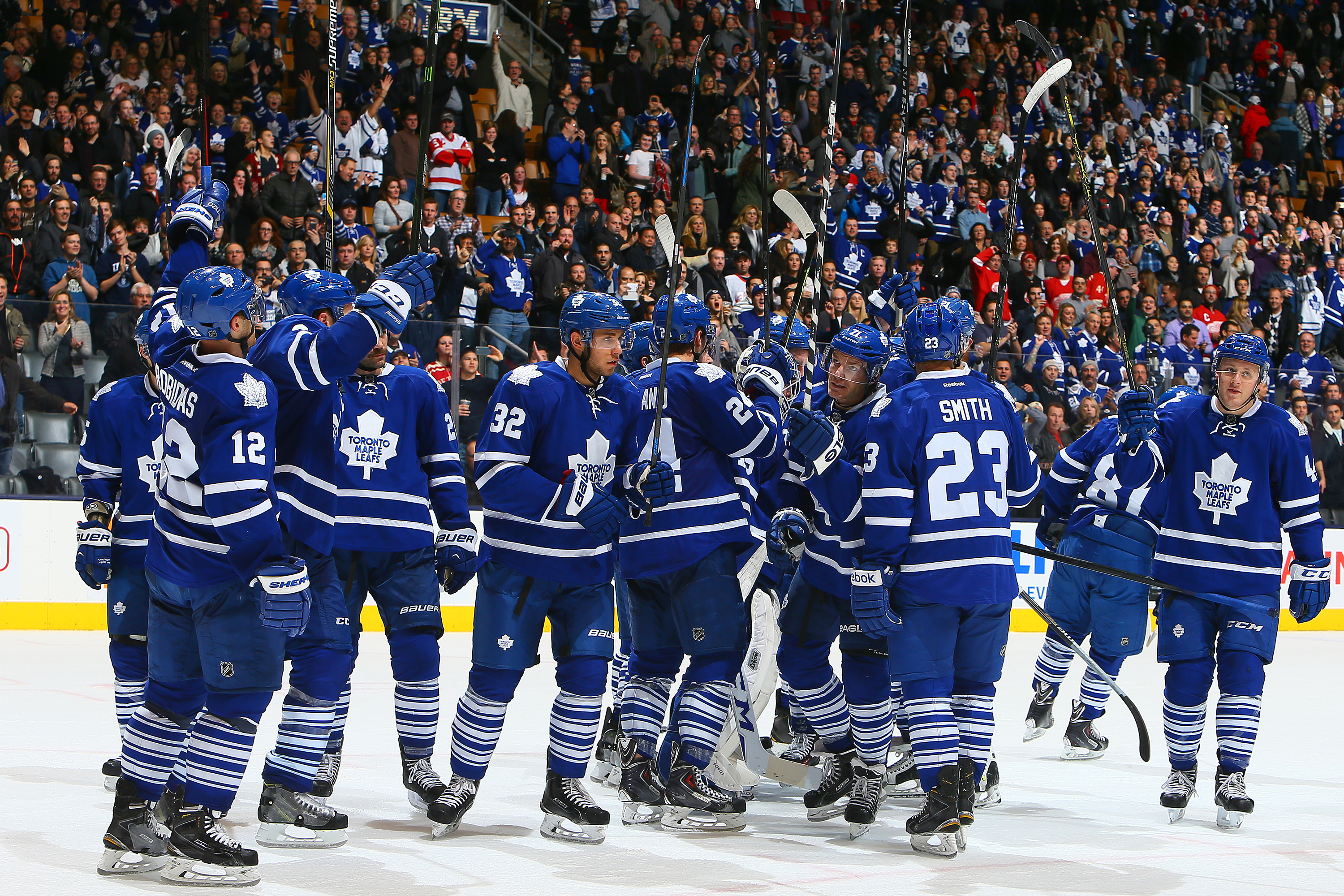 The Toronto Maple Leafs salute the fans after beating the Detroit Red Wings during an NHL game at the Air Canada Centre in Toronto on Nov. 22, 2014. NHLI/Getty Images/Graig Abel