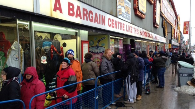Hundreds wait in line for the annual turkey giveaway at Honest Ed's in Toronto on Dec. 14, 2014. CITYNEWS/Ken Hama