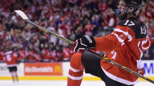 Canada's Connor McDavid celebrates his goal against Denmark with teammates Fredrik Gauthier (22) during second period quarter-final action at the World Junior Hockey Championships in Toronto on Jan. 2, 2015. THE CANADIAN PRESS/Frank Gunn