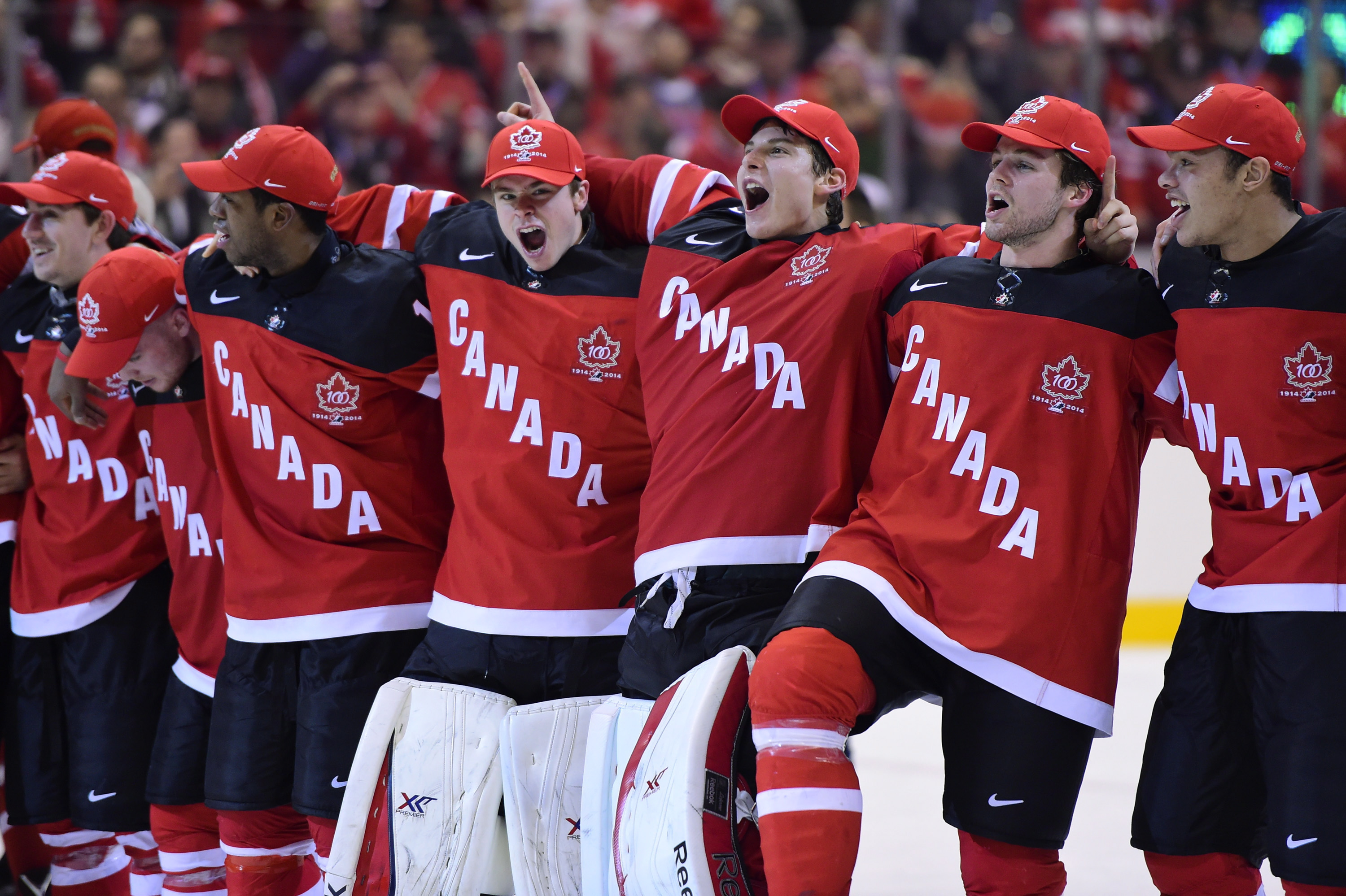 Canadian players celebrate Canada's 5-4 win over Russia during the gold medal game hockey action at the IIHF World Junior Championship in Toronto on Jan. 5, 2015. THE CANADIAN PRESS/Frank Gunn