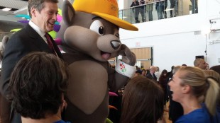 Mayor John Tory stands next to the Pan Am Games mascot Pachi at the ceremonial handover of the Athletes' Village in Toronto on Feb. 20, 2015. TWITTER/John Tory