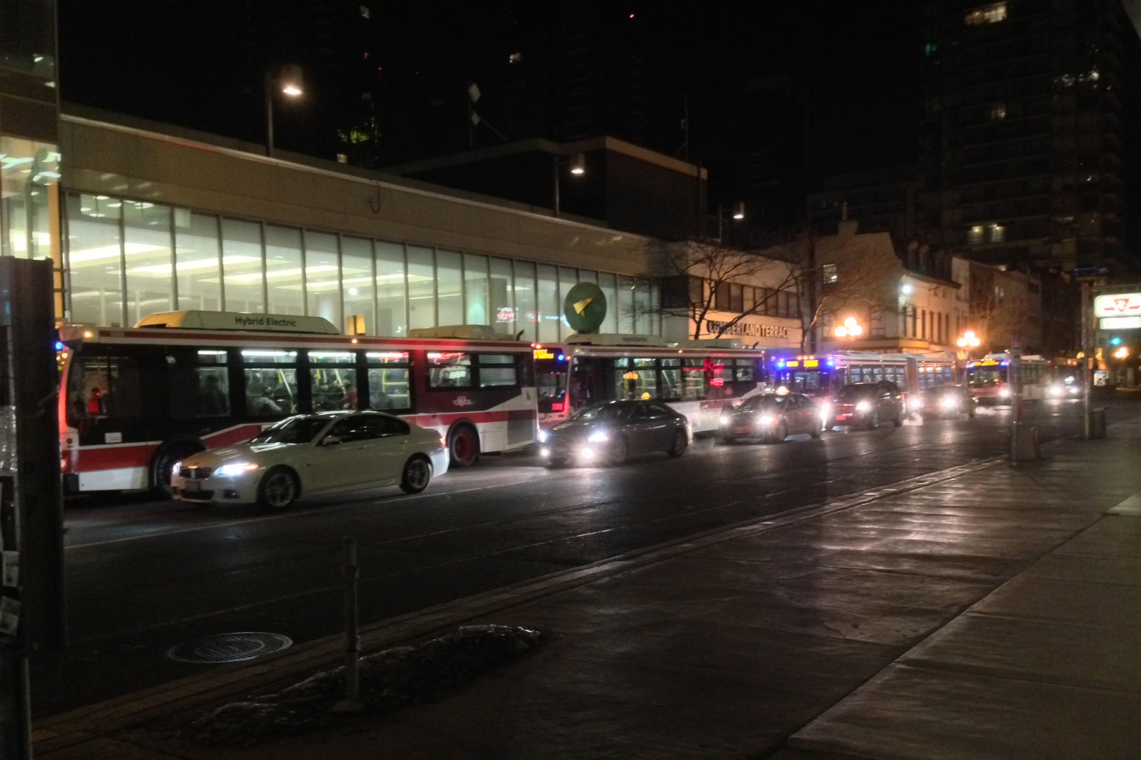 Shuttle buses wait to transport passengers after a subway shutdown between Bloor and Union stations on March 24, 2015. CITYNEWS/Bert Dandy