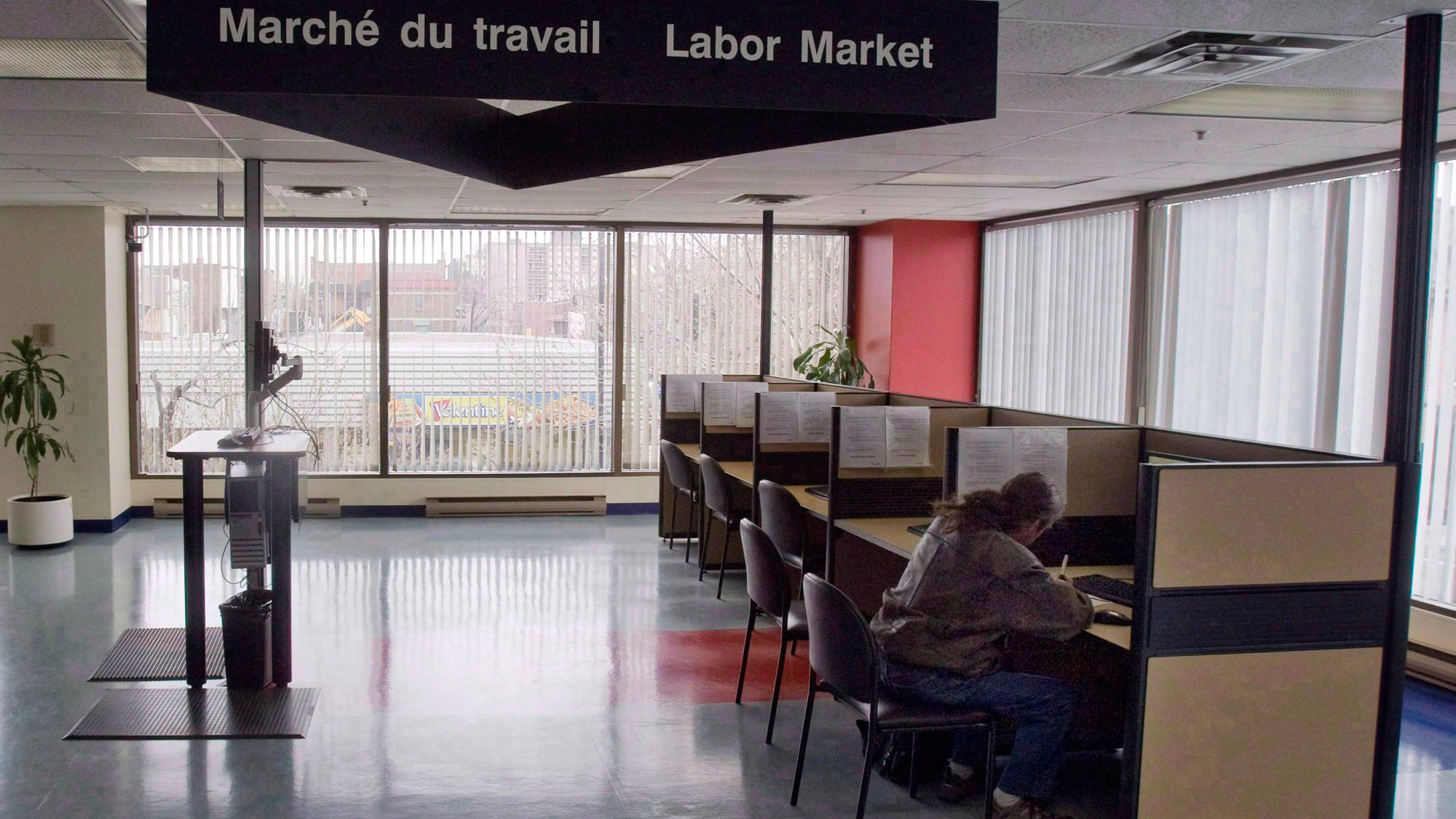 A Man Looks Through Jobs At Resource Canada Offices In Montreal April 9 2009 THE CANADIAN PRESS Ryan Remiorz