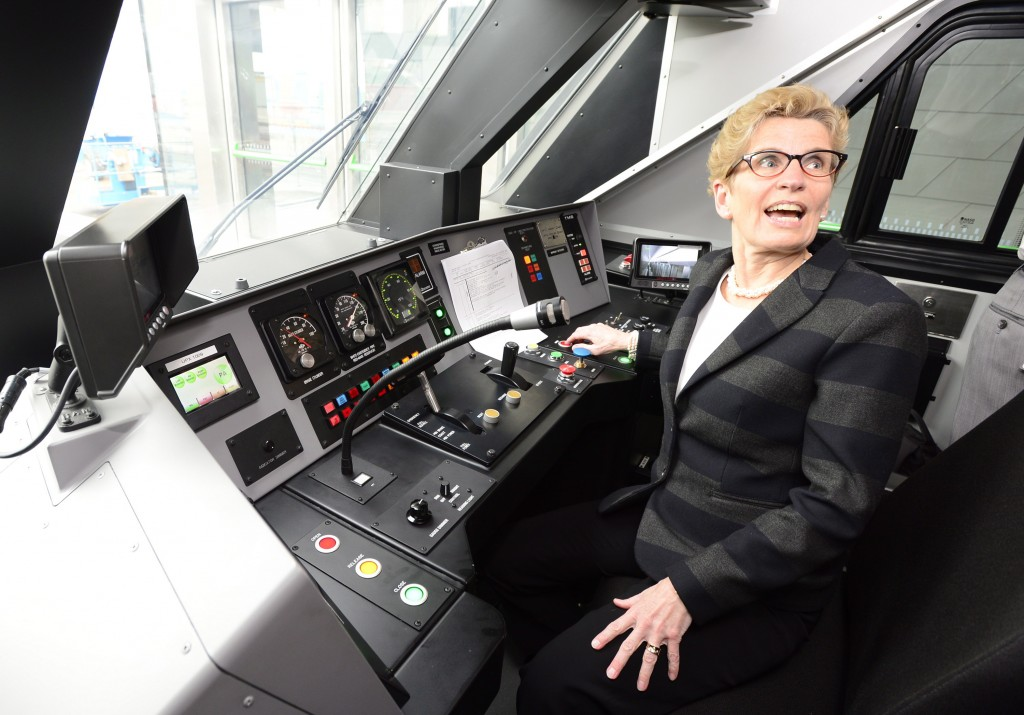 Ontario Premier Kathleen Wynne takes the controls of the Union Pearson Express train from Union Station to Pearson airport in Toronto on Wednesday, April 22, 2015. THE CANADIAN PRESS/Frank Gunn