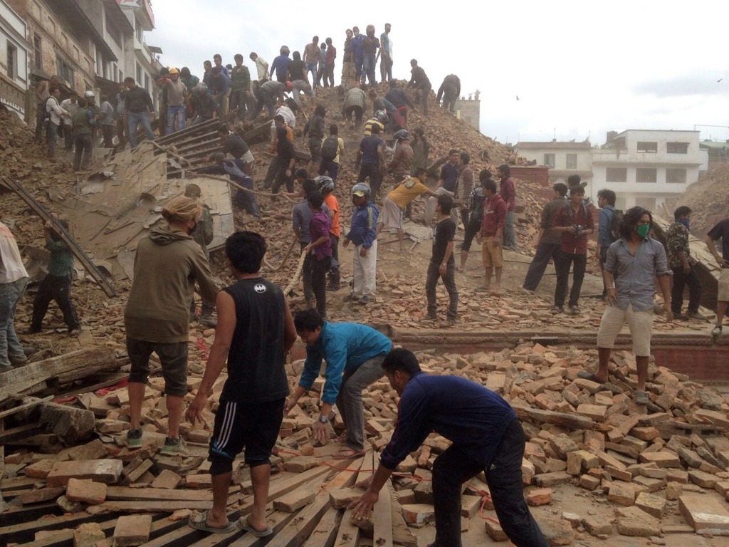 Volunteers help with rescue work at the site of a building that collapsed after an earthquake in Kathmandu, Nepal, Saturday, April 25, 2015. A strong magnitude-7.9 earthquake shook Nepal's capital and the densely populated Kathmandu Valley before noon Saturday, causing extensive damage with toppled walls and collapsed buildings, officials said. THE ASSOCIATED PRESS/ Niranjan Shrestha