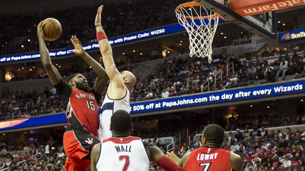 Toronto Raptors' Amir Johnson goes up for a shot against Washington Wizards' Marcin Gortat during Game 4 of their playoff series in Washington, DC, on April 26, 2015. ANADOLU AGENCY/Getty Images/Samuel Corum