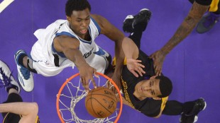 Minnesota Timberwolves forward Andrew Wiggins, left, dunks as Los Angeles Lakers guard Jordan Clarkson defends during the second half of an NBA basketball game on April 10, 2015, in Los Angeles. THE ASSOCIATED PRESS/Mark J. Terrill