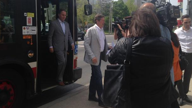 Councillor Josh Colle, left, and Mayor John Tory, right, meet with media during an announcement regarding TTC bus and streetcar service on Sunday, May 24, 2015. (CityNews/Anna Vlachos)