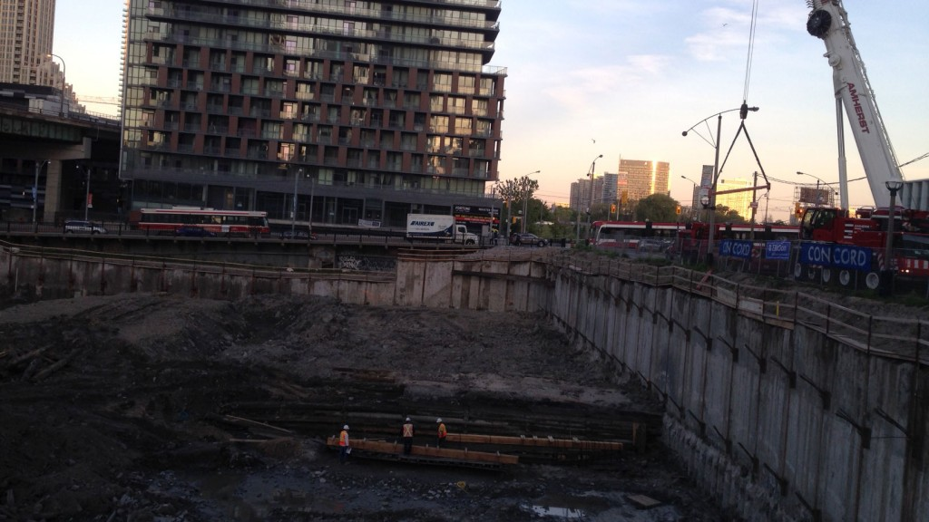 Crews getting ready to excavate and move the 19th-Century schooner at the Queen's Wharf. CITYNEWS/Bert Dandy