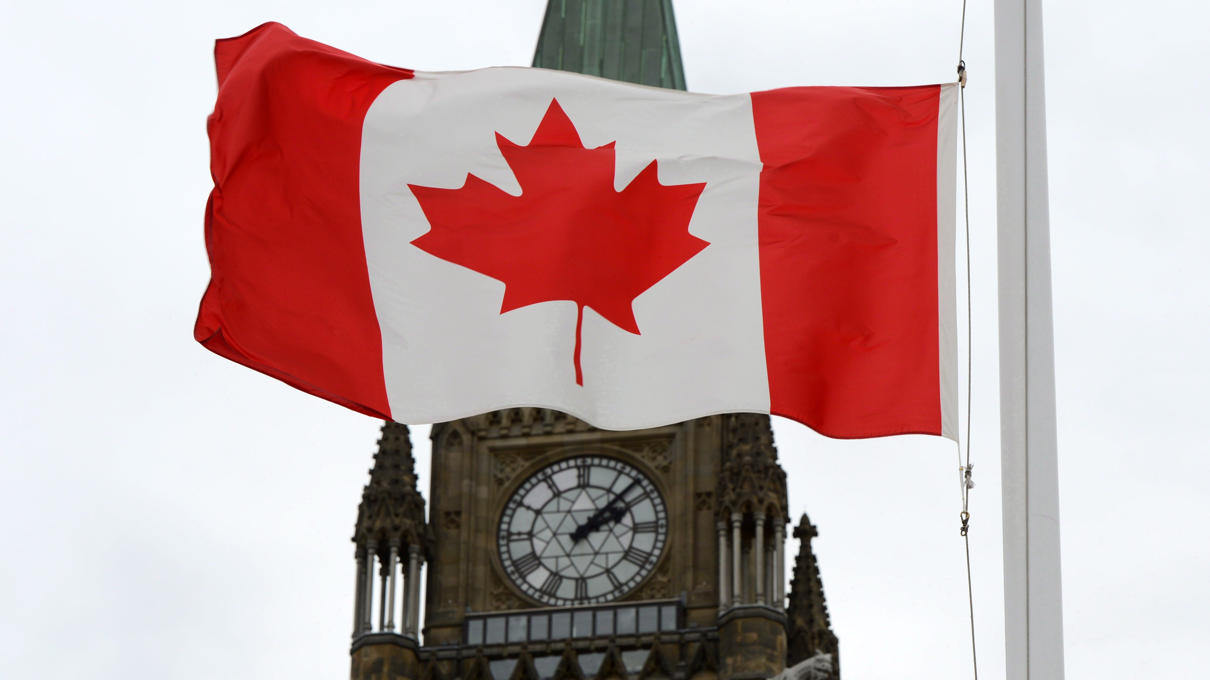 A Canadian flag blows in front of the Peace Tower on Parliament Hill in Ottawa, Oct. 24, 2012. THE CANADIAN PRESS/Sean Kilpatrick