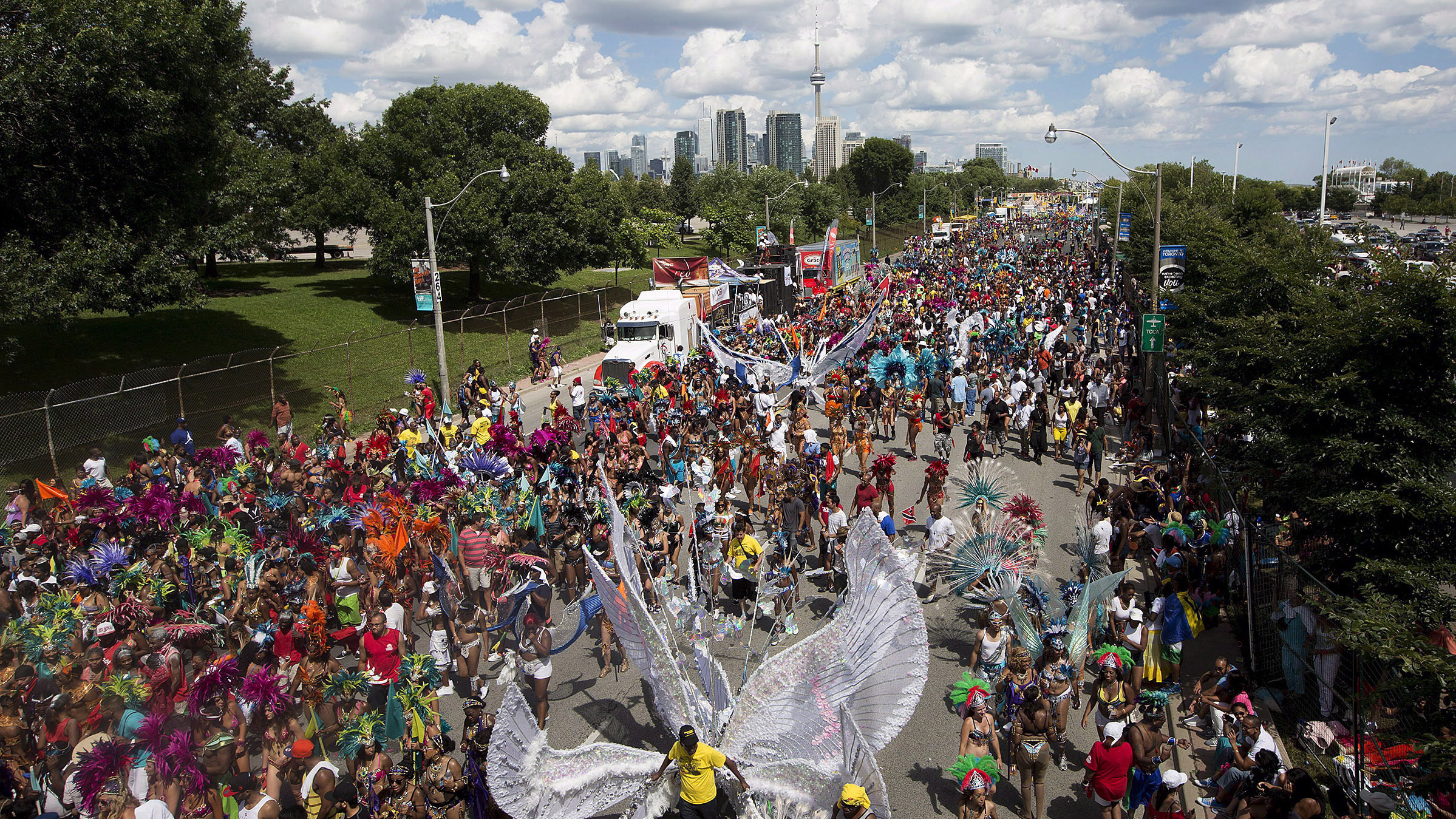 Paraders march down Lakeshore Boulevard at the Caribbean Carnival in Toronto on August 3, 2013. THE CANADIAN PRESS/Michelle Siu.