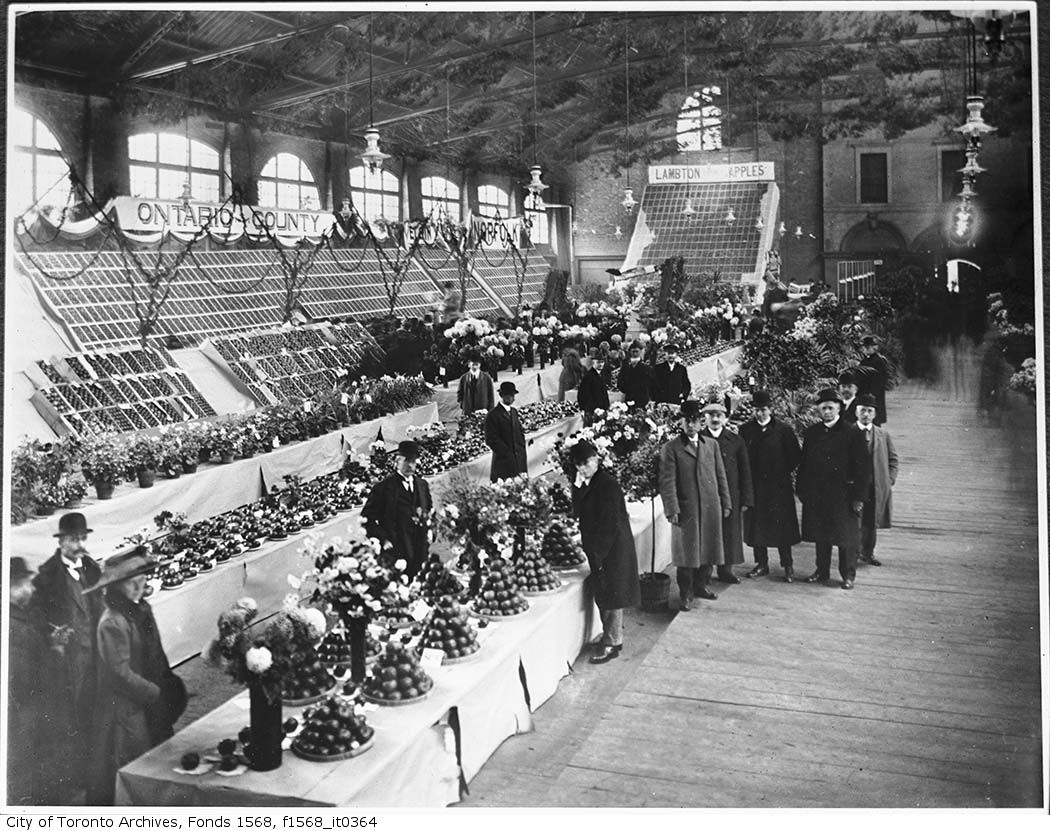 Fruit and flower stalls at the St. Lawrence Market, circa 1904. Image via City of Toronto Archives/Alexander W. Galbraith fonds.