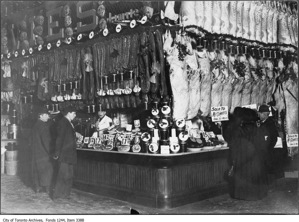 William Davies stall at the St. Lawrence Market, circa 1911. Image via City of Toronto Archives/William James fonds.