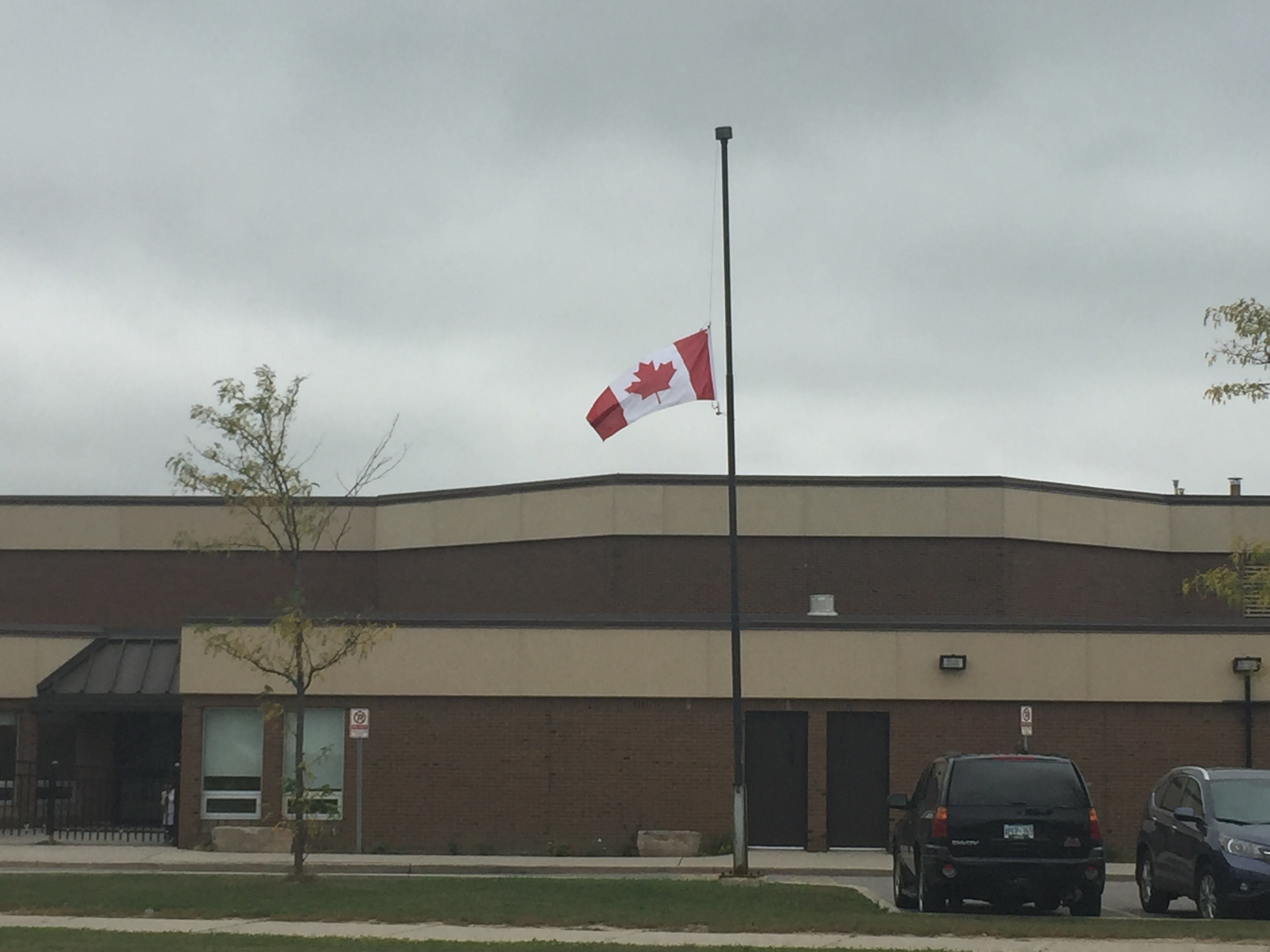 A flag is at half-mast at St. Joachim Elementary School in Brampton after three children and their grandfather were killed in a crash on Sept. 27, 2015. CITYNEWS/Shauna Hunt.