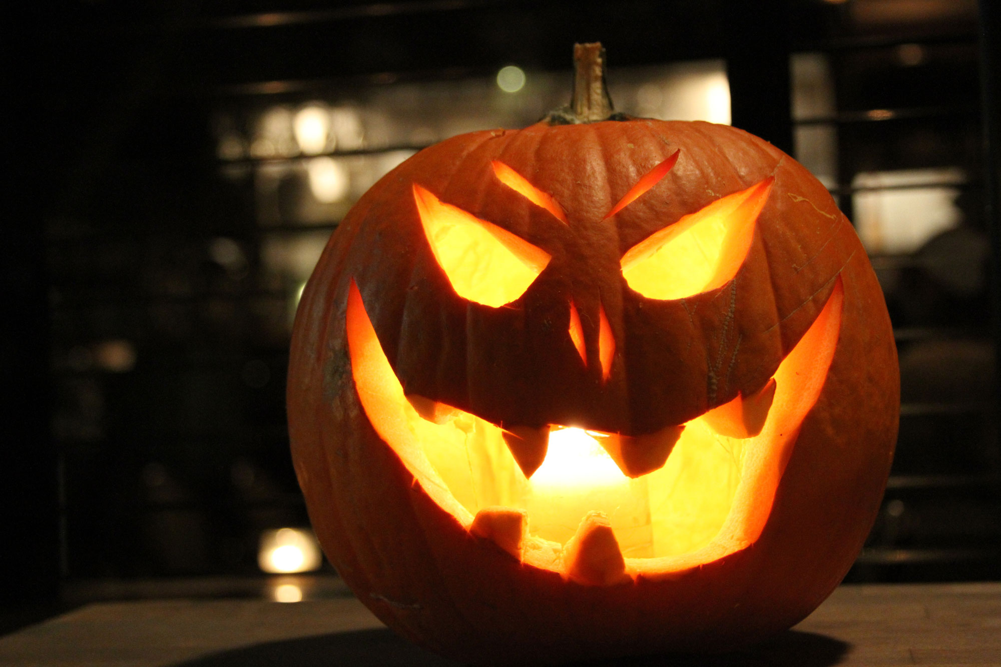 An illuminated Jack-O-Lantern. GETTY IMAGES/Ashley Sandberg/EyeEm