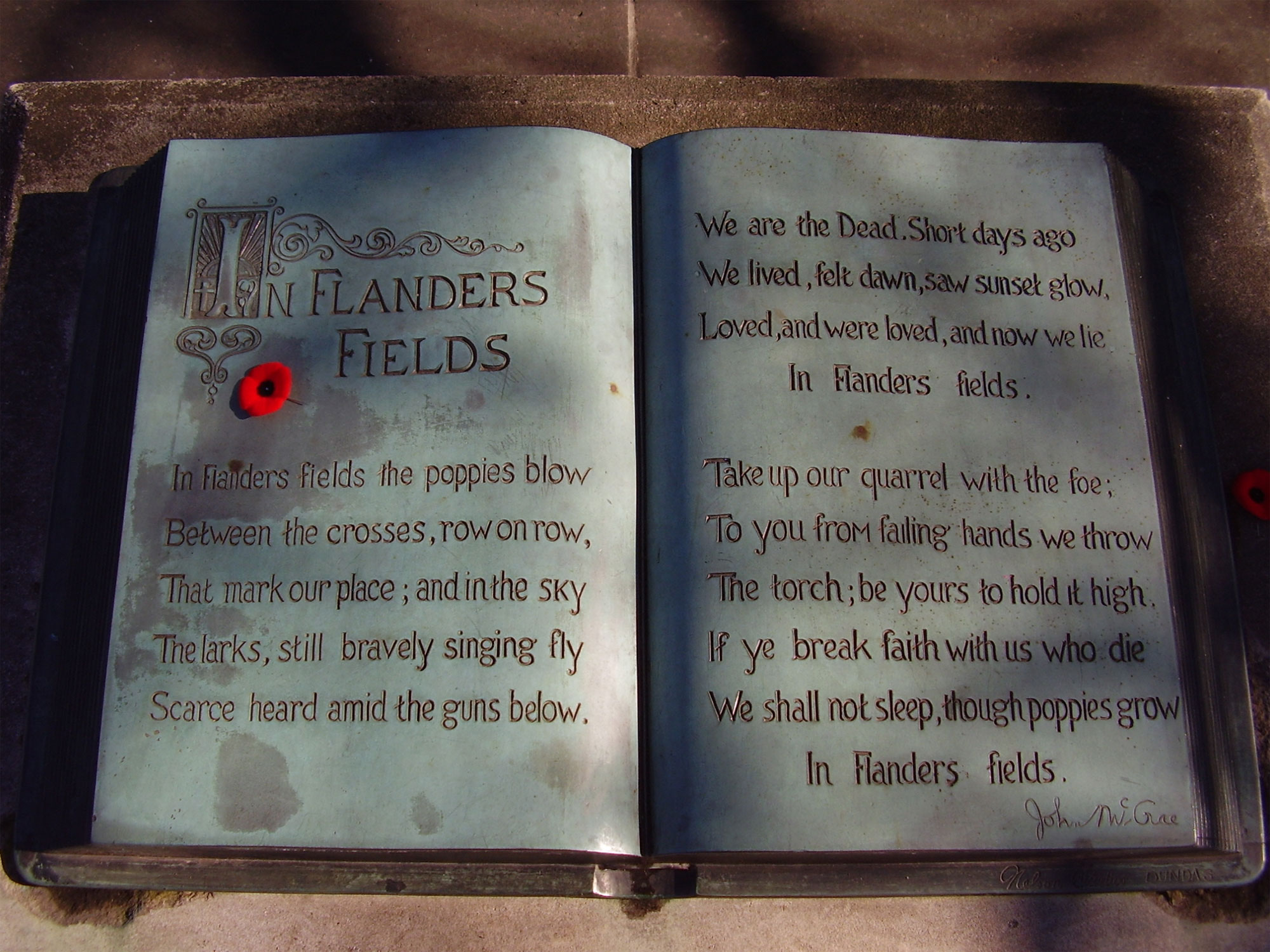 "Inscription of the poem ""In Flanders Fields"" in a book at the John McCrae memorial in Guelph, Ont., on Nov. 11, 2009. CREATIVE COMMONS/Lx 121"