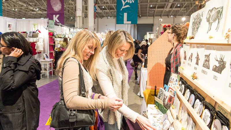 People shopping at the One of a Kind Christmas Show. Photo via facebook.com/oneofakindtoronto.