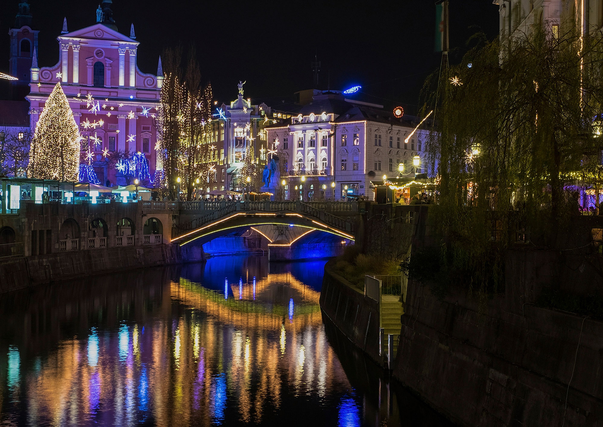 Christmas lights on buildings in the old town reflect on the river Ljubljanica in Ljubljana, Slovenia, on Dec. 2, 2015. GETTY IMAGES/Marco Secchi.