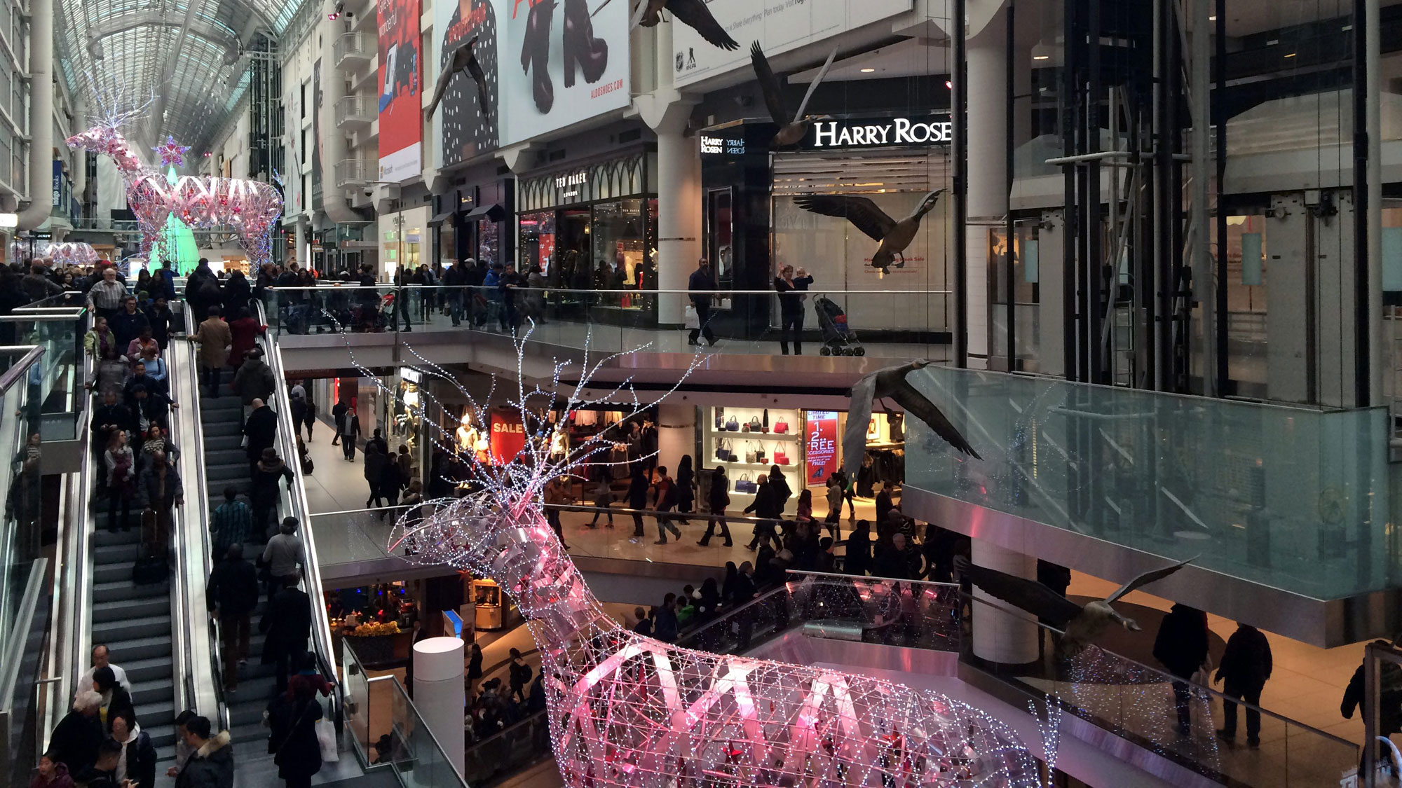 People shopping at the Eaton Centre on the day before Christmas Eve in Toronto on Dec. 23, 2014. THE CANADIAN PRESS IMAGES/Rachel Verbin.