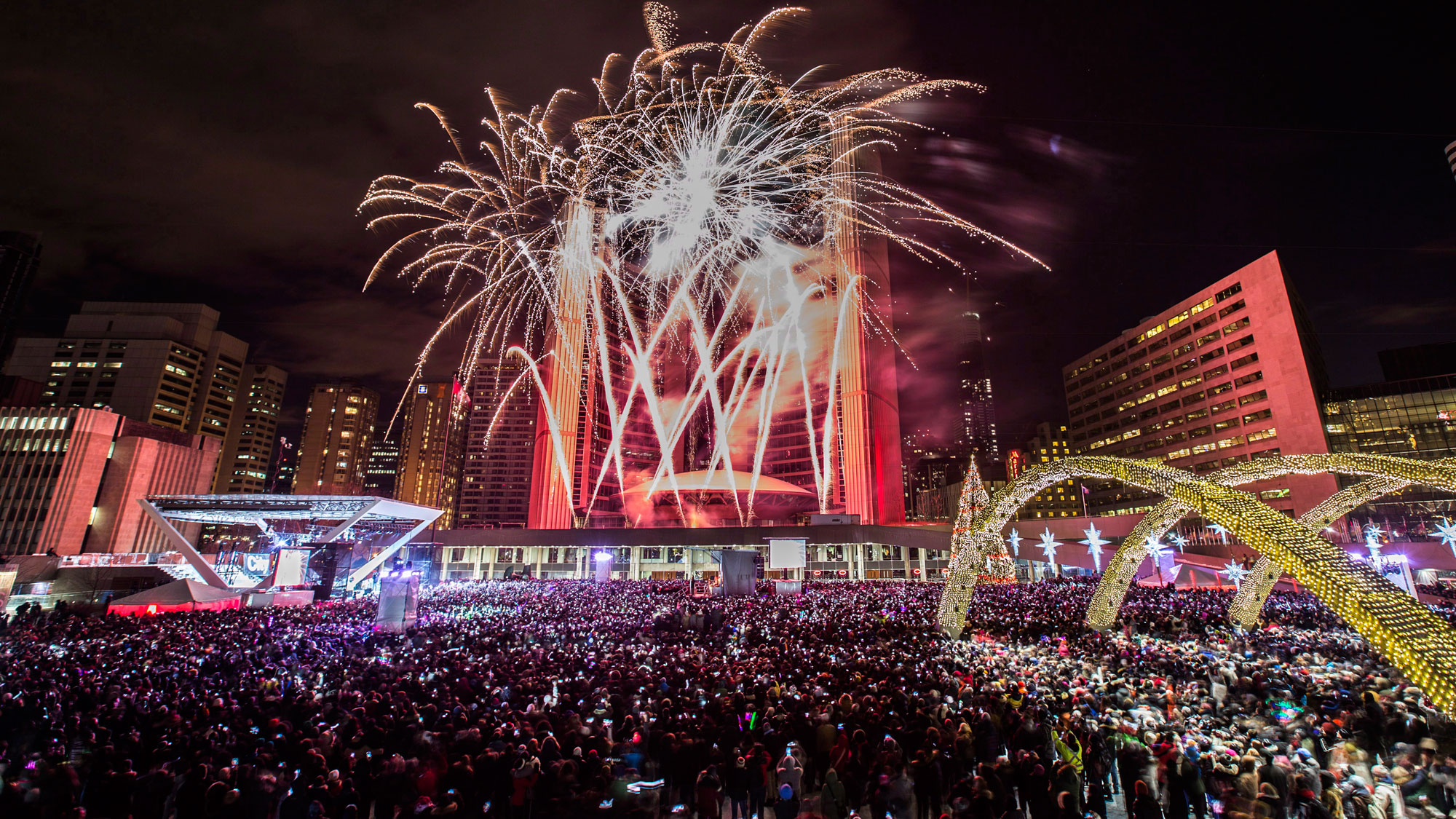 Fireworks during New Year's Eve celebrations at Nathan Phillips Square in Toronto on Jan. 1, 2014. THE CANADIAN PRESS/Mark Blinch.