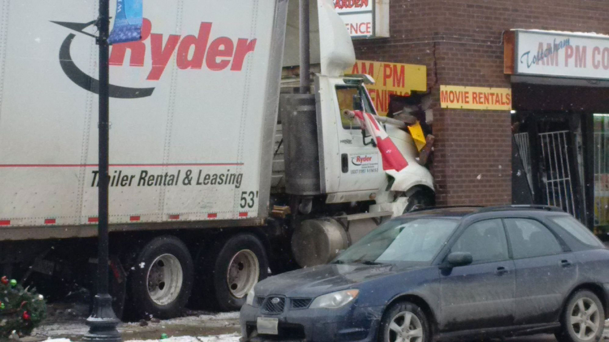 A tractor-trailer crashed into a strip mall in downtown Tottenham, west of Newmarket, on Jan. 14, 2016. CityNews viewer/Mike Sura.