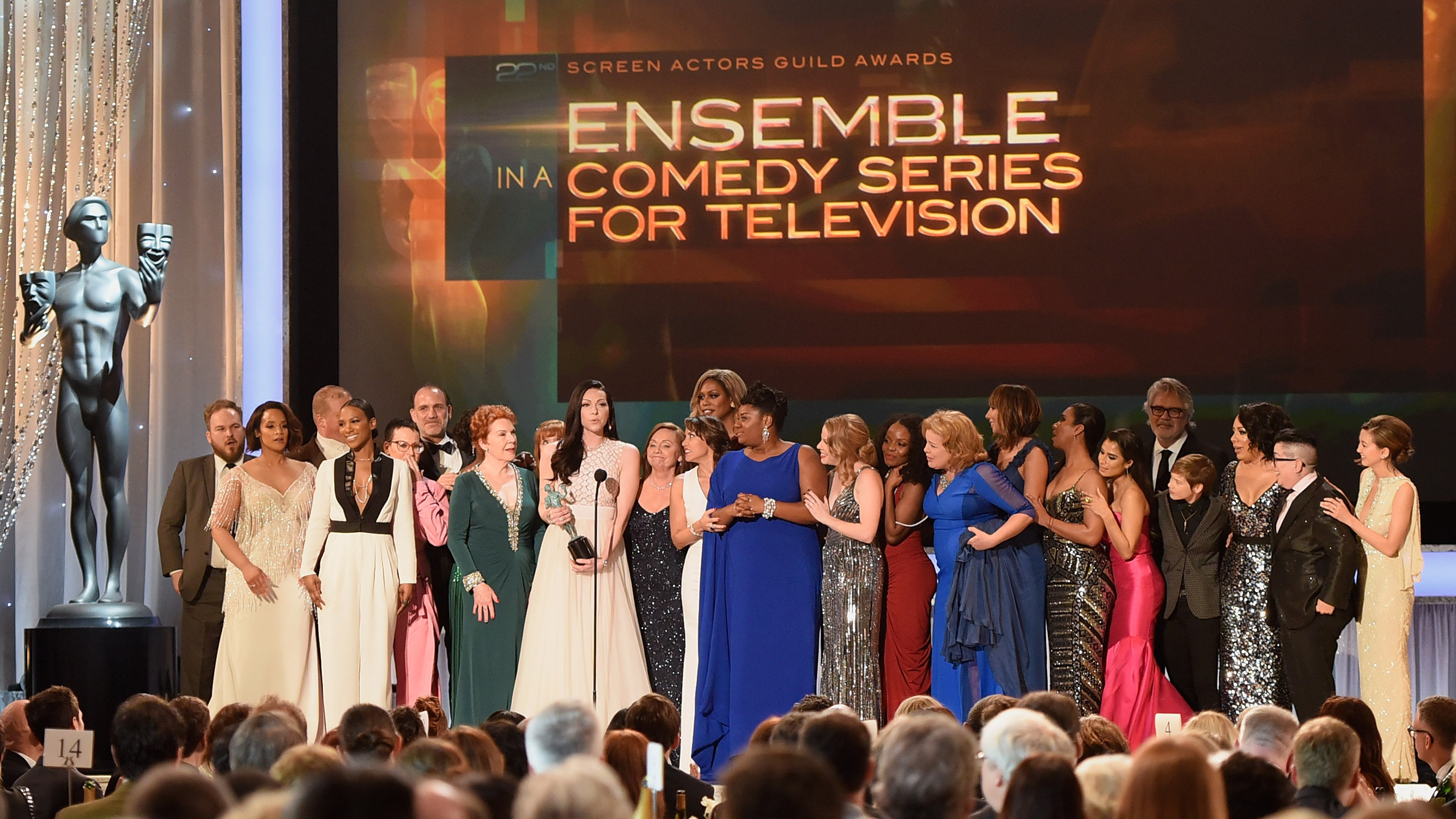 LOS ANGELES, CA - JANUARY 30:  The cast of 'Orange Is the New Black,' including actors Vicky Jeudy, Lori Petty, Uzo Aduba, Kate Mulgrew, Annie Golden, Laura Prepon, Dale Soules, Laverne Cox, and Michelle Hurst, accept Outstanding Performance by an Ensemble in a Comedy Series award onstage at the 22nd Annual Screen Actors Guild Awards at The Shrine Auditorium on January 30, 2016 in Los Angeles, California.  (Photo by Angela Weiss/Getty Images for Screen Actors Guild Foundation)