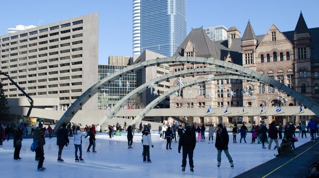 People skating at Nathan Phillips Square. Photo via Twitter/@HiltonToronto.