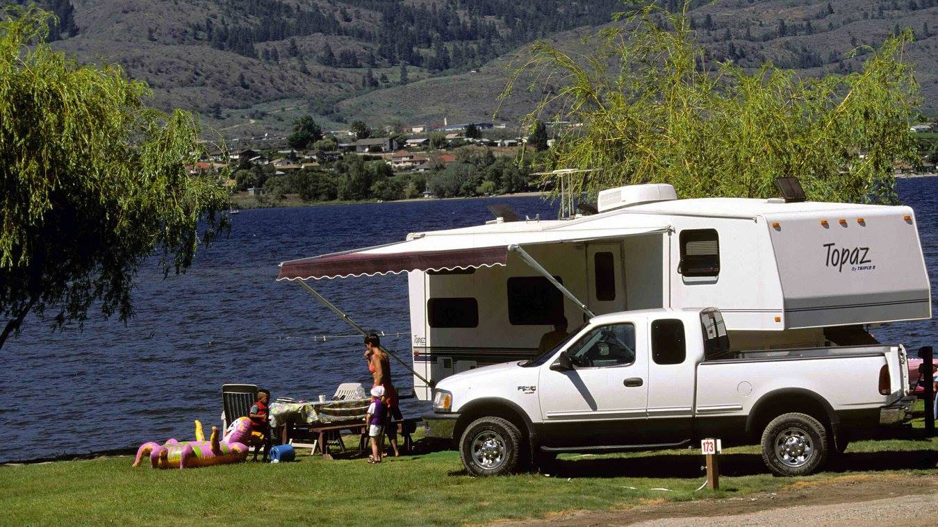 A family hanging out near their RV. Photo via Facebook/TorontoSpringCampingRVShowandSale.