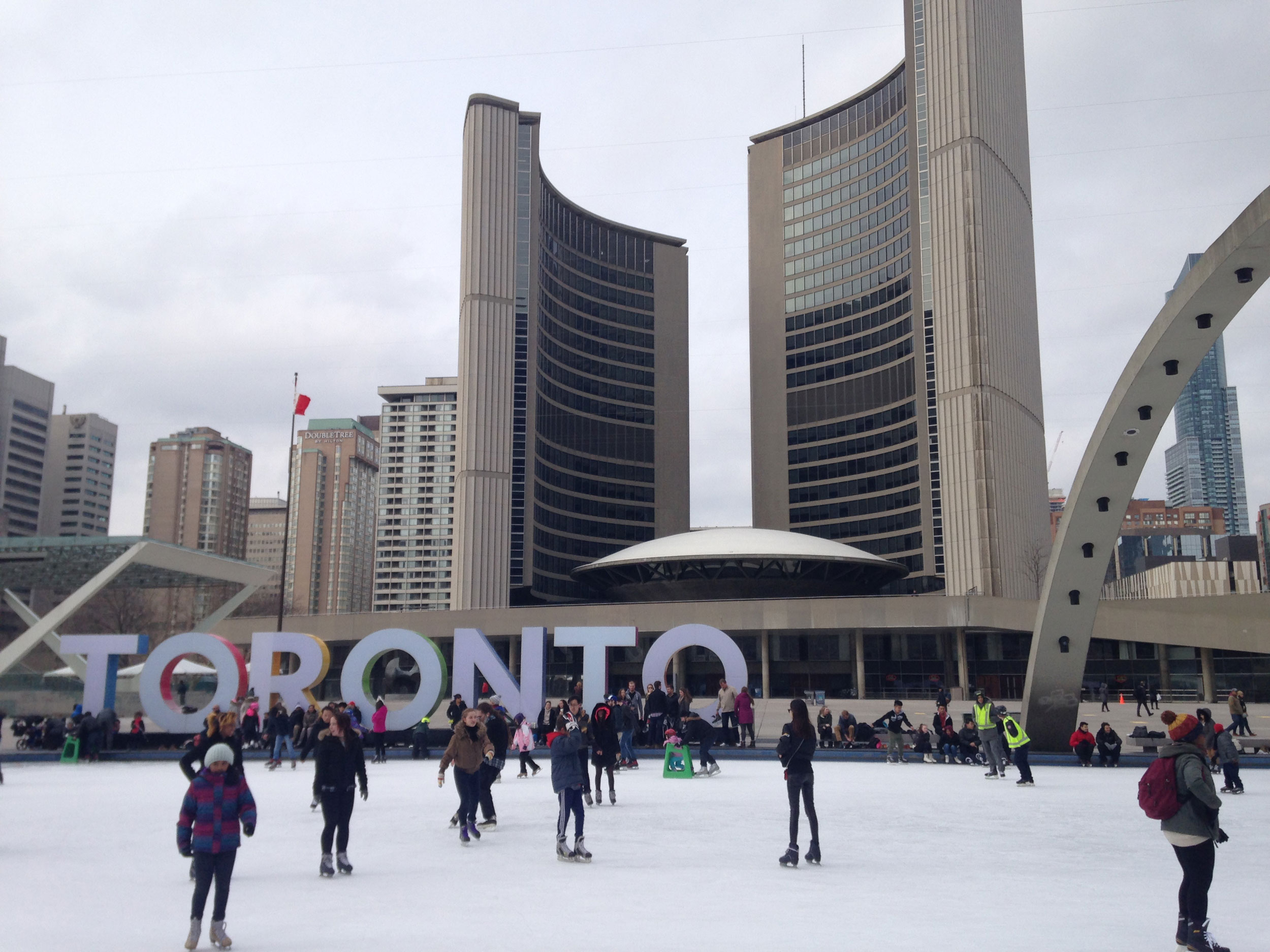 Skaters at Nathan Phillips Square with the 'Toronto' sign in the background. 680 NEWS/Patricia D'Cunha.