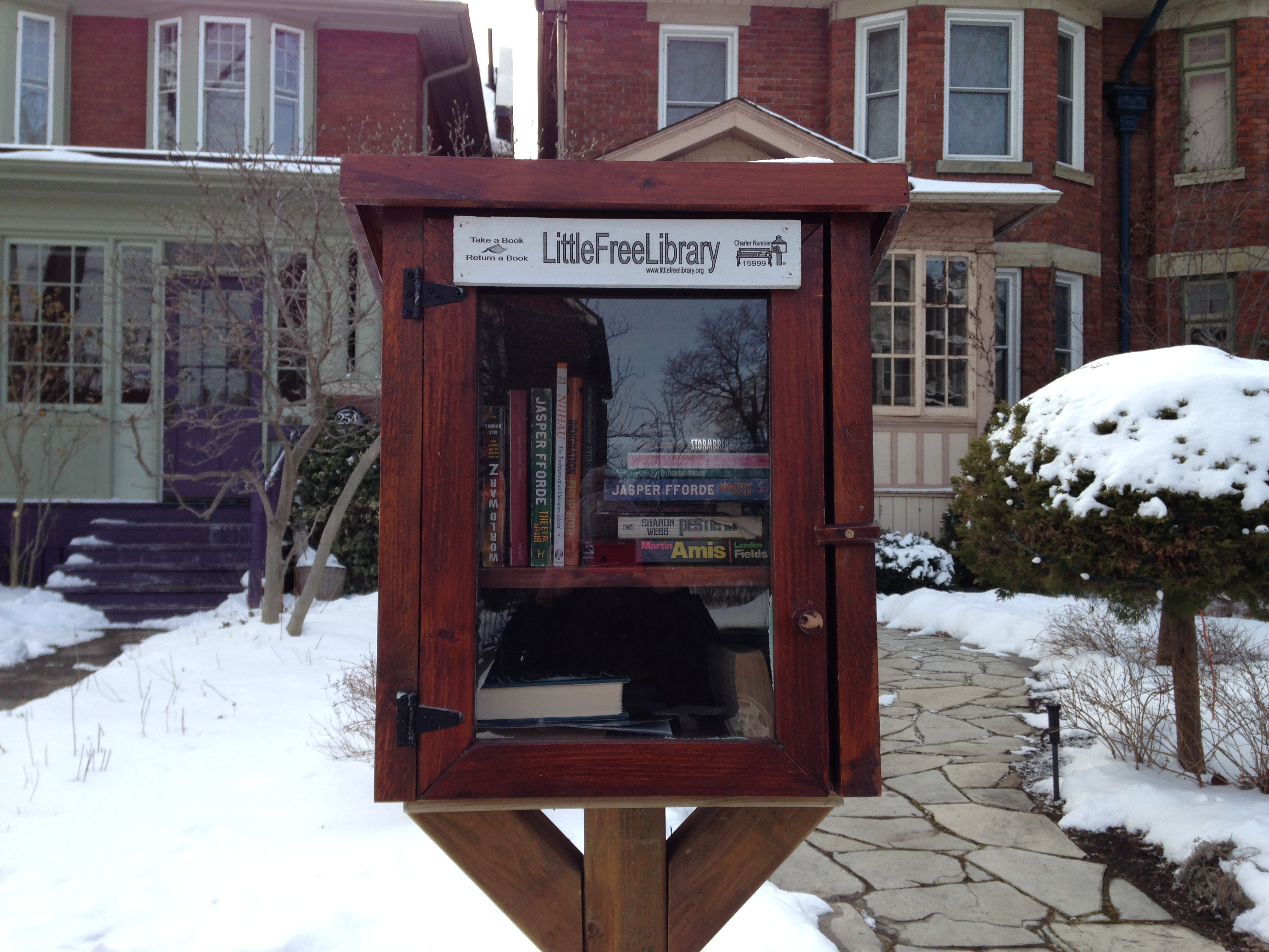 The Little Free Library book box on Rusholme Street, located next door to the Open Field Collective's Street Project. CITYNEWS/Patricia D'Cunha.