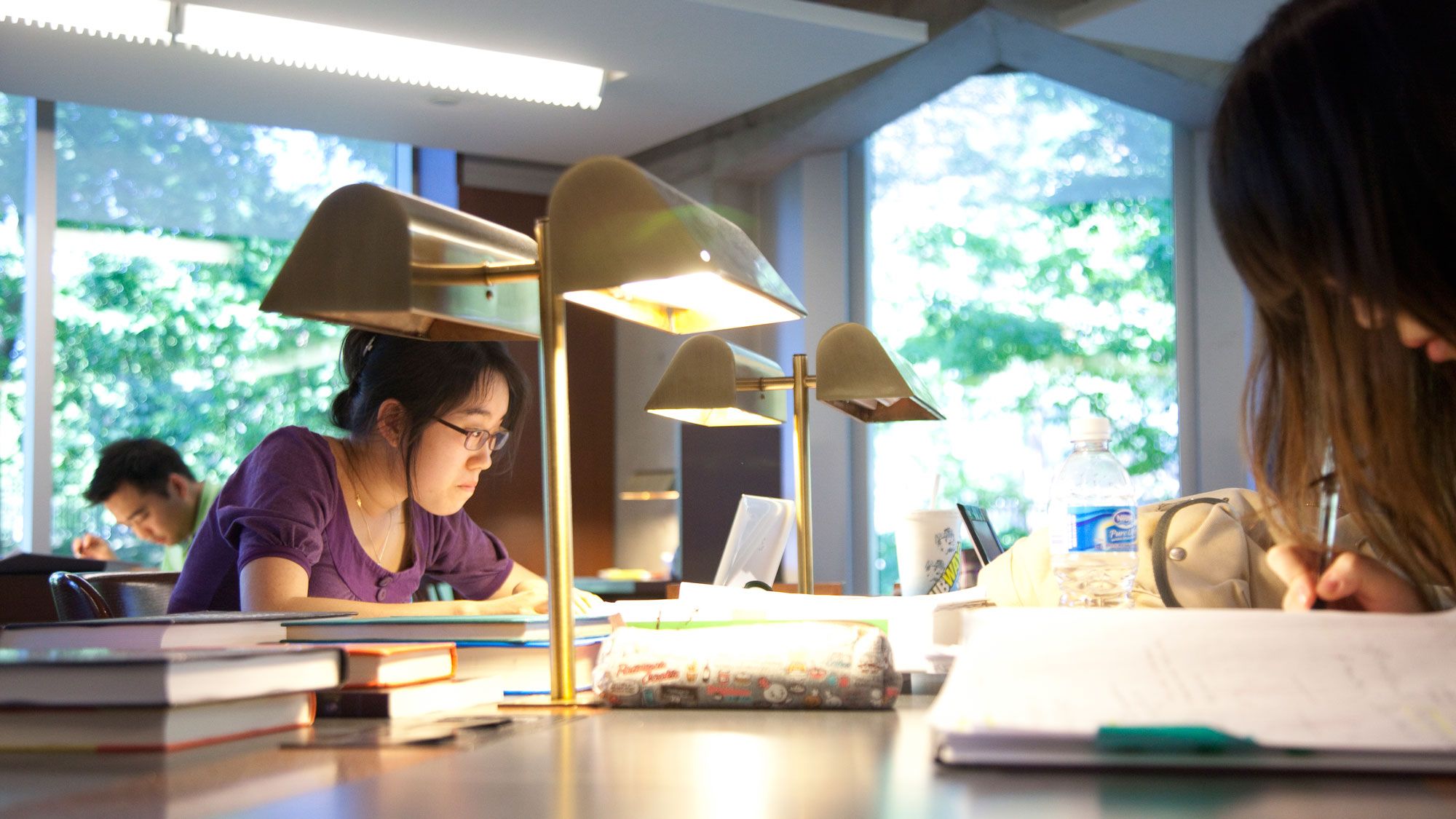 Students studying in a library at the University of Toronto. UNIVERSITY OF TORONTO.