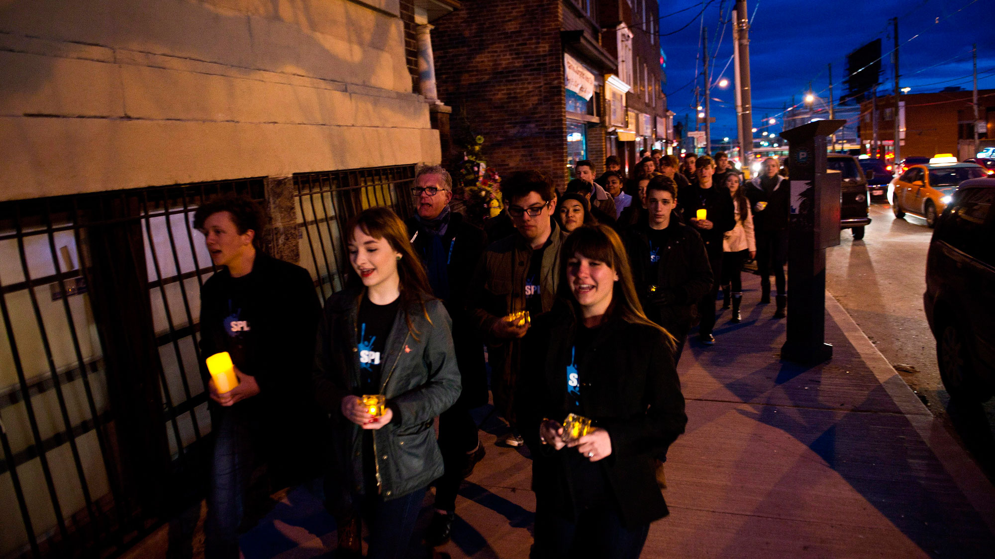 Members of SPLASH, the Etobicoke School of the Arts' show choir sing during a WWF-Canada lantern walk in Roncesvalles Village, celebrating Earth Hour, on March 23, 2013. THE CANADIAN PRESS/Galit Rodan