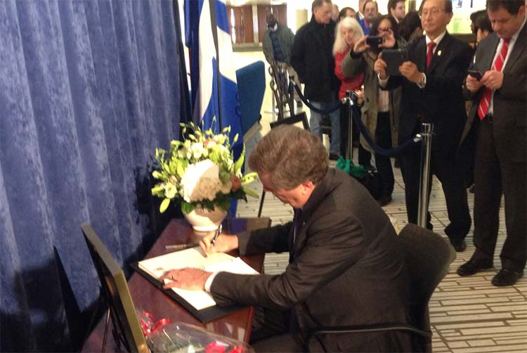Toronto Mayor John Tory signs the condolence book for Rob Ford.