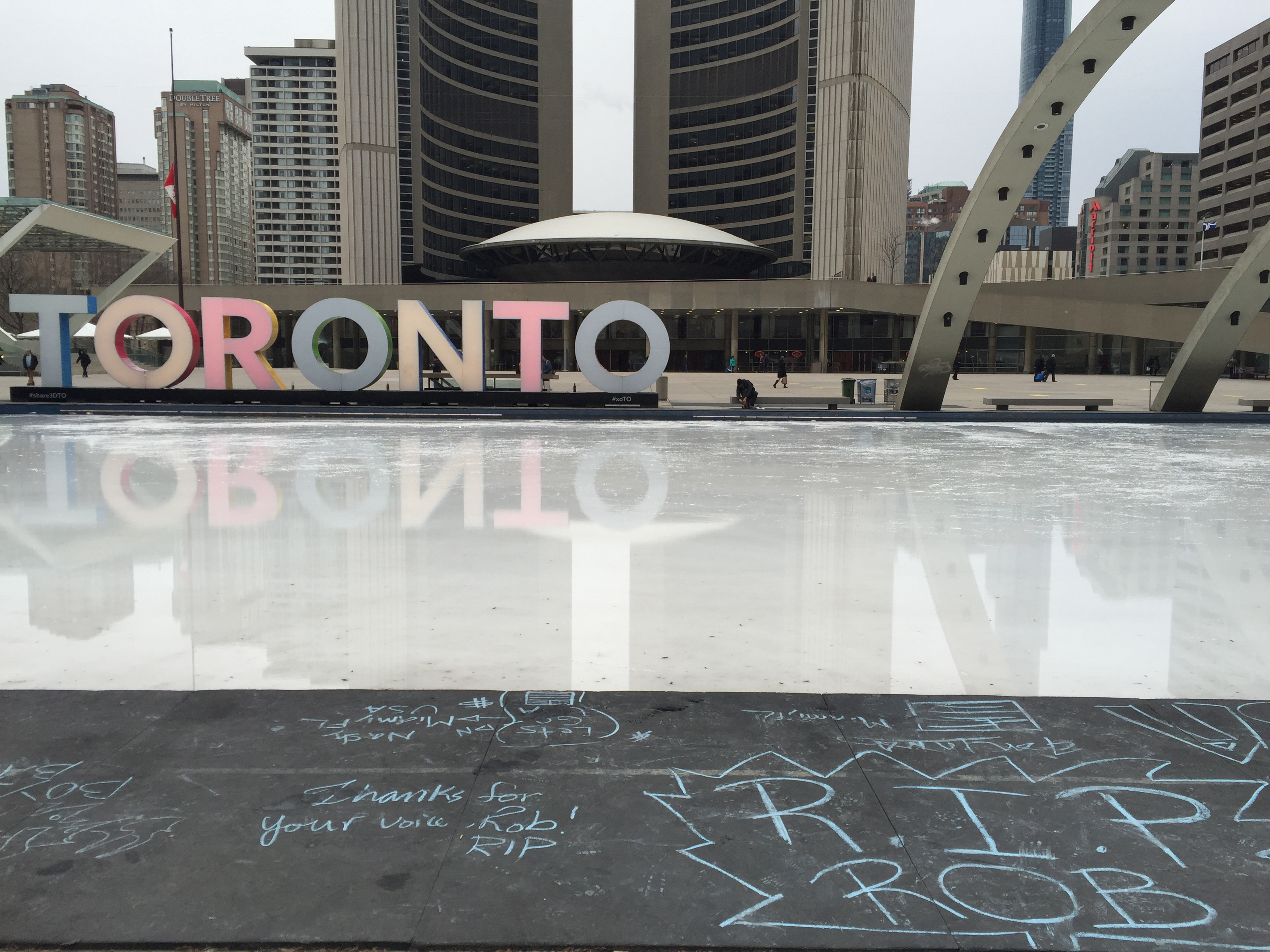 Rob Ford chalk memorial near Toronto sign at Nathan Phillips Square