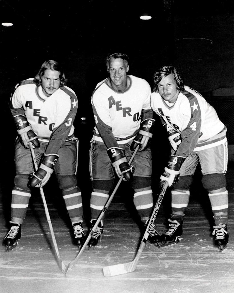 Former Detroit Red Wings great Gordie Howe, center, is flanked by sons Marty, left, and Mark as they try their new Houston Aeros uniforms in St. Clair Shores, Mich., on Aug. 3, 1973. THE CANADIAN PRESS/AP - The Macomb Daily, David Posavetz *MANDATORY CREDIT*
