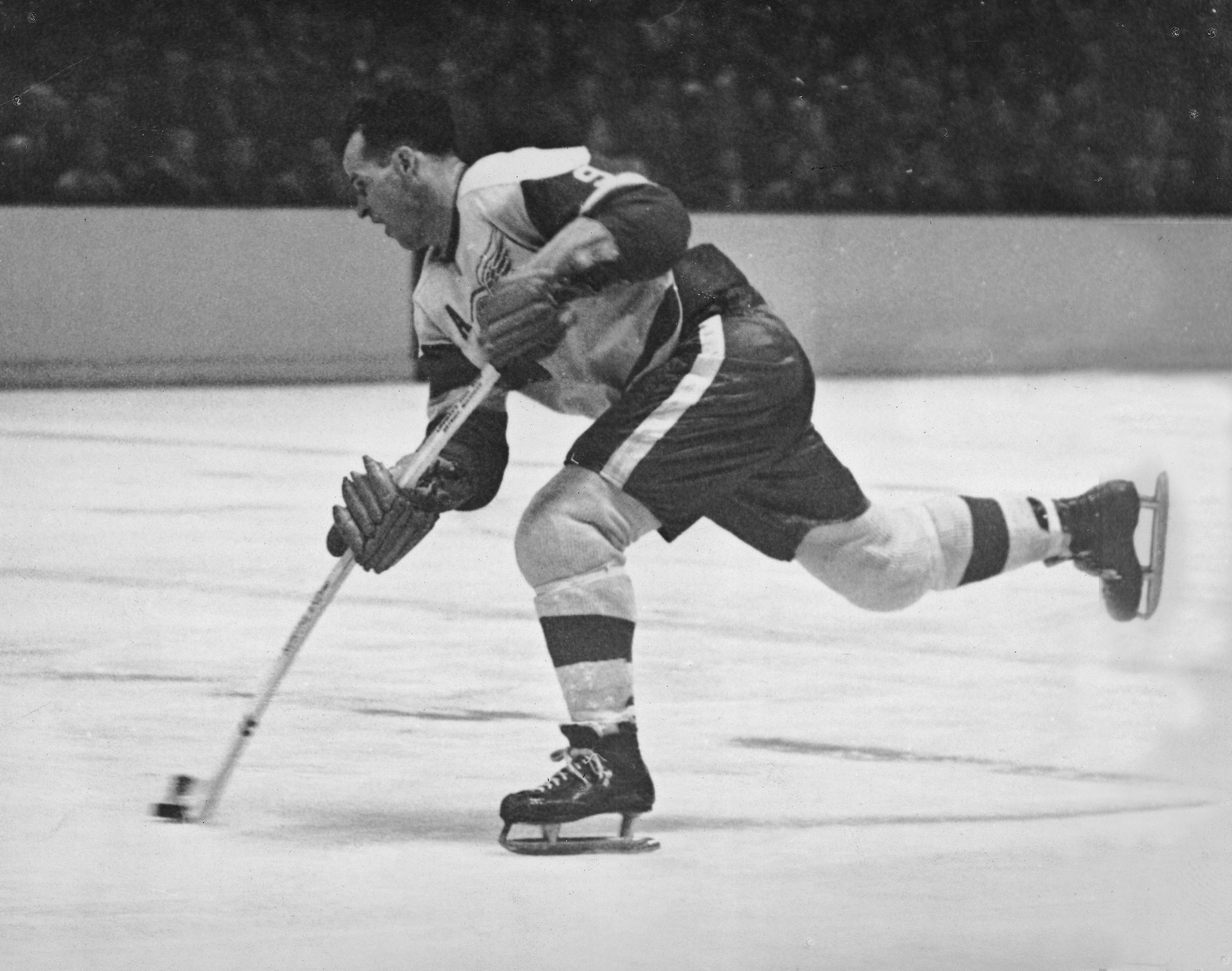 Canadian hockey player Gordie Howe of the Detroit Red Wings fires a shot during a game, late 1950s or early 1960s. GETTY IMAGES/Robert Riger